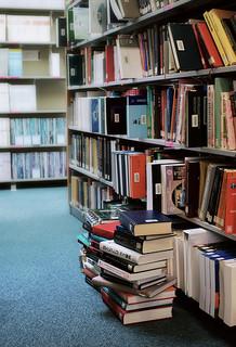 Library Stacks by JanneM, via Flickr