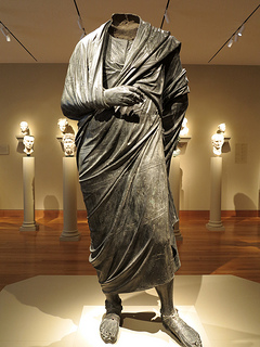 Depiction of a Roman Emperor wearing a toga. This image is via Flickr by Mr. T in DC.